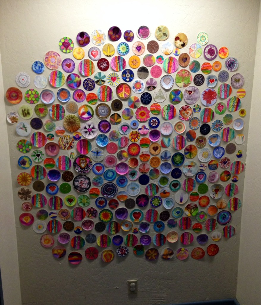 A growing wall of mandalas. A little dark but you get the picture!